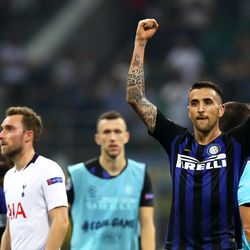 Matias Vecino of Inter Milan celebrates his team's victory at full-time of the Group B match of the UEFA Champions League between FC Internazionale and Tottenham Hotspur at San Siro Stadium on September 18, 2018 in Milan, Italy.