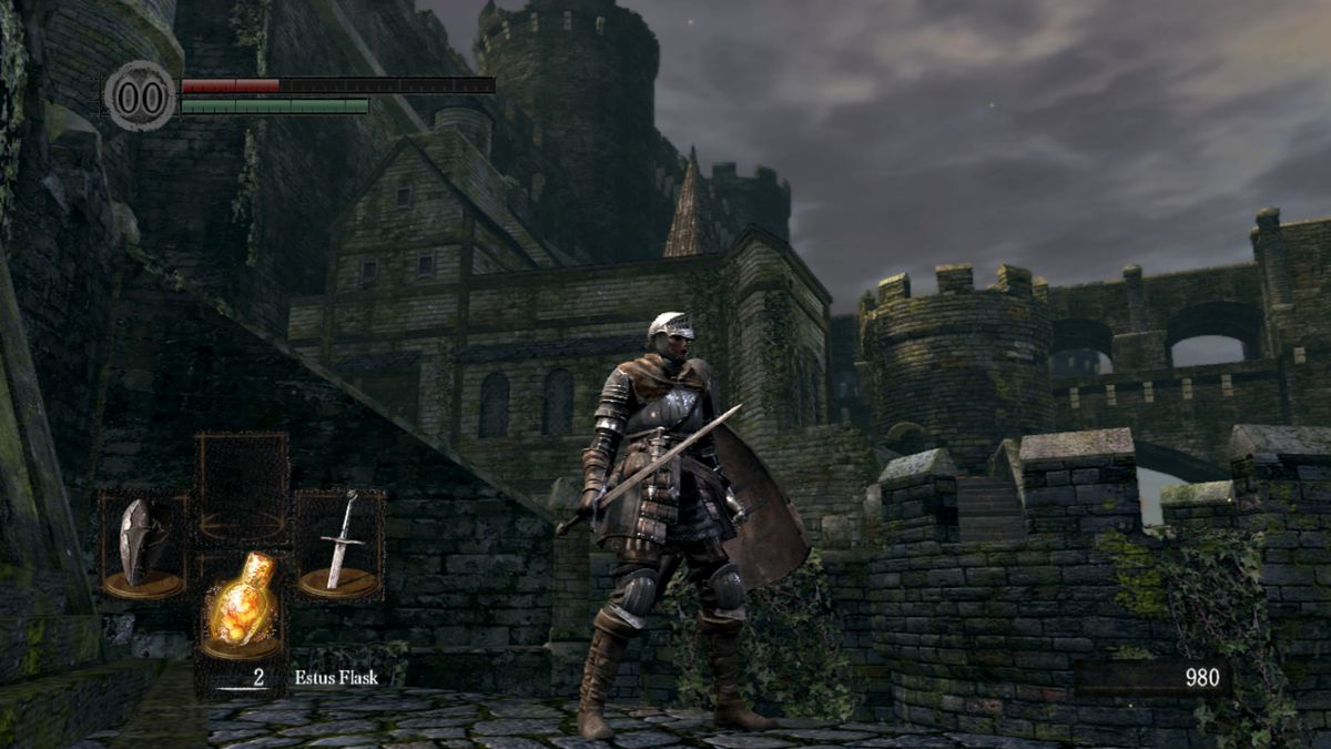 The Dark Souls player character explores the Undead Burg with a sword and shield