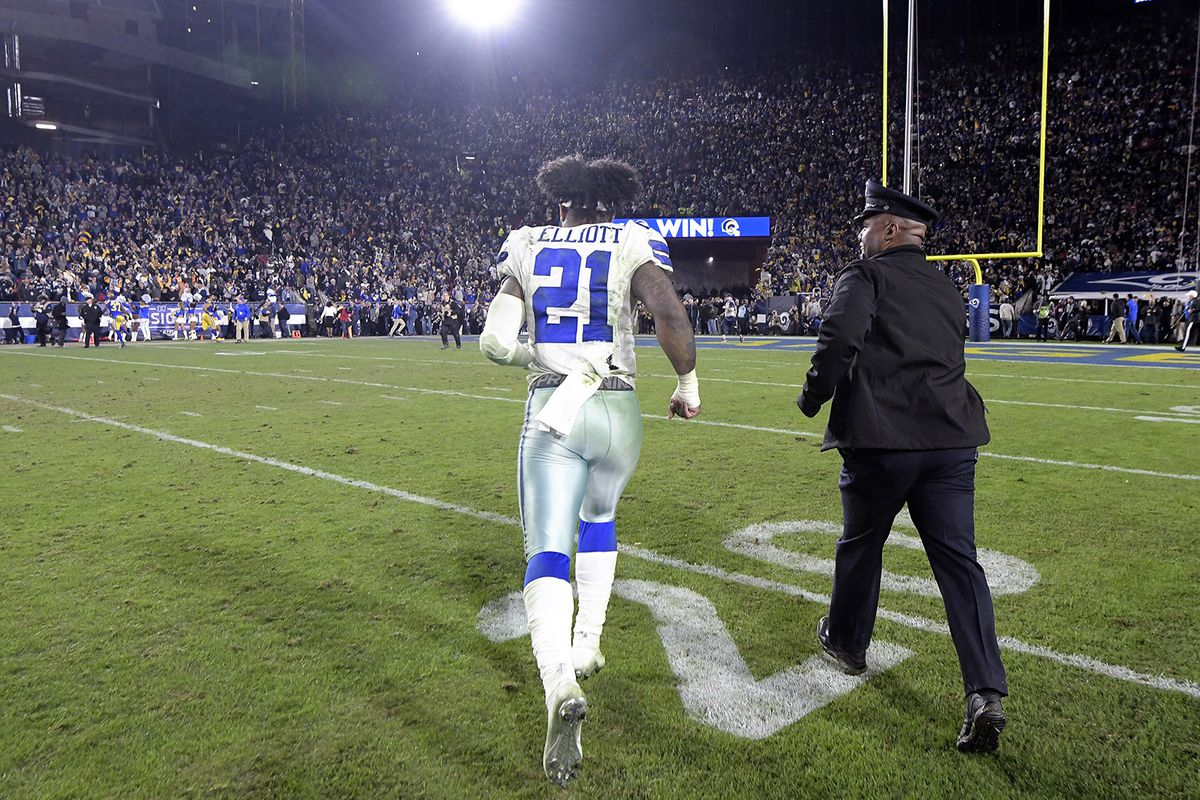 Dallas Cowboys running back Ezekiel Elliott runs off the field after a 30-22 loss against the Los Angeles Rams in the NFL Divisional Round at the Los Angeles Memorial Coliseum on Saturday, Jan. 12, 2019.