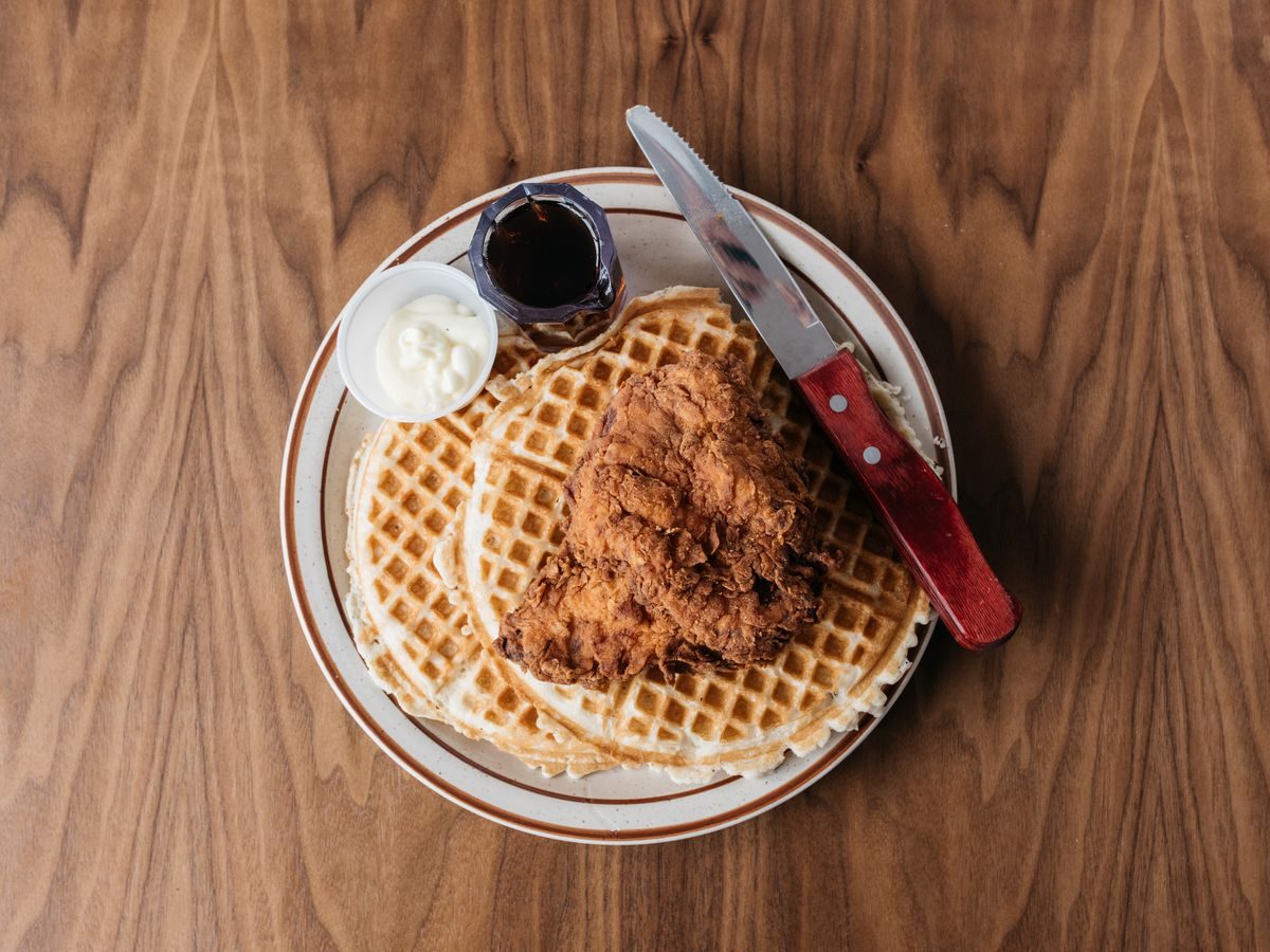 Fried chicken on top of waffles at Fat's Chicken and Waffles in Seattle
