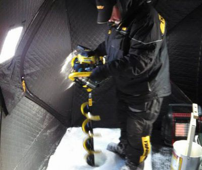 Will southern Lake Michigan ever see a scene like this, Jeff Norris drilling a hole for ice fishing whitefish on Green Bay?<br>Dale Bowman/Sun-Times