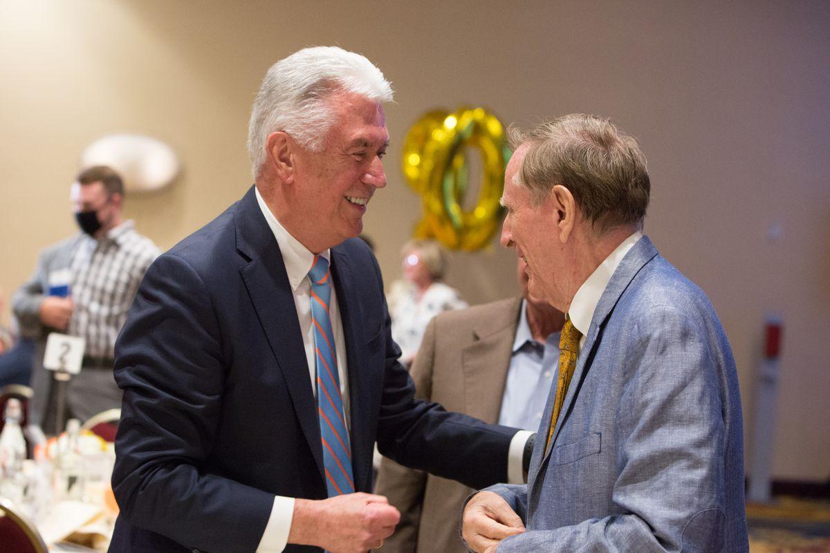 Elder Dieter F. Uchtdorf speaks with author, historian and scholar Richard Bushman at a dinner.