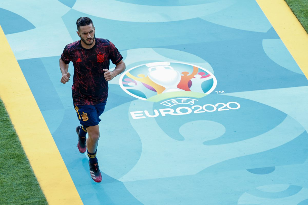 """Jorge Resurreccion """"Koke"""" of Spain runs over the Euro 2020 logo during the UEFA Euro 2020 Championship Group E match between Spain and Poland at Estadio La Cartuja on June 19, 2021 in Seville, Spain."""