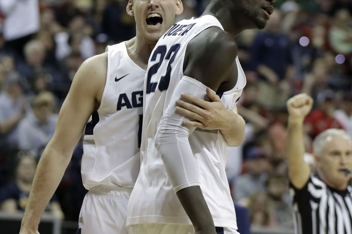 Utah State's Quinn Taylor, left, and Neemias Queta react after a foul call during the first half of an NCAA college basketball game against San Diego State in the Mountain West Conference men's tournament championship Saturday, March 16, 2019, in Las Vega