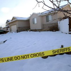 A woman and her two daughters were found dead in an apparent murder-suicide at this home in Syracuse on Wednesday, Jan. 14, 2014.