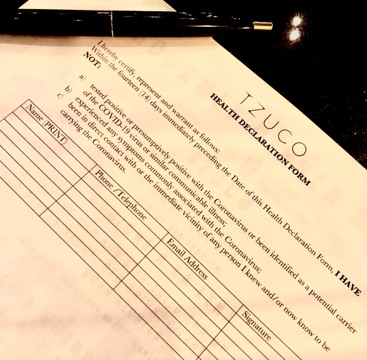 A paper that's a contract tracing form.