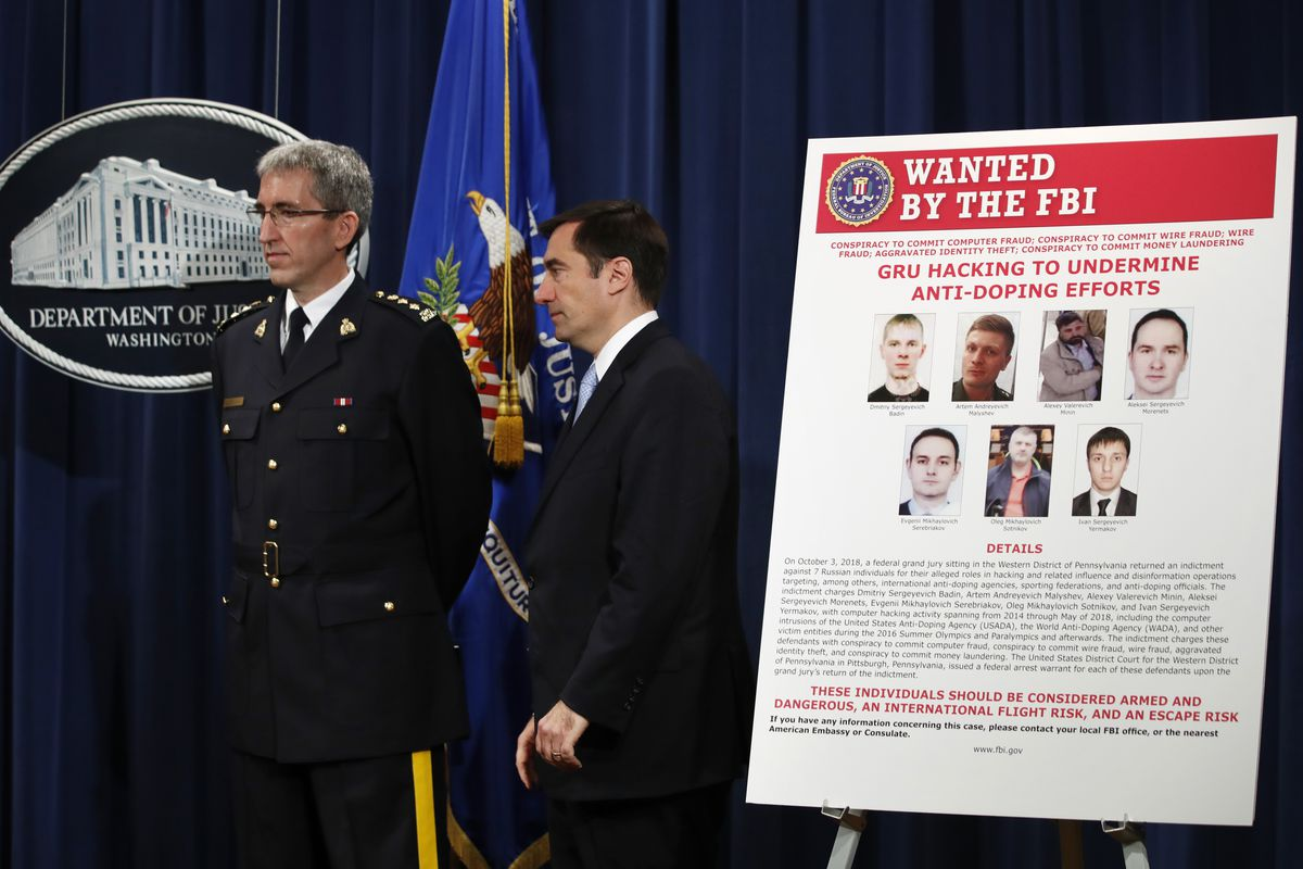 Mark Flynn, Director General for the Royal Canadian Mounted Police, left, and Assistant Attorney General for National Security John Demers, attend a news conference, Thursday, Oct. 4, 2018, at the Justice Department in Washington.