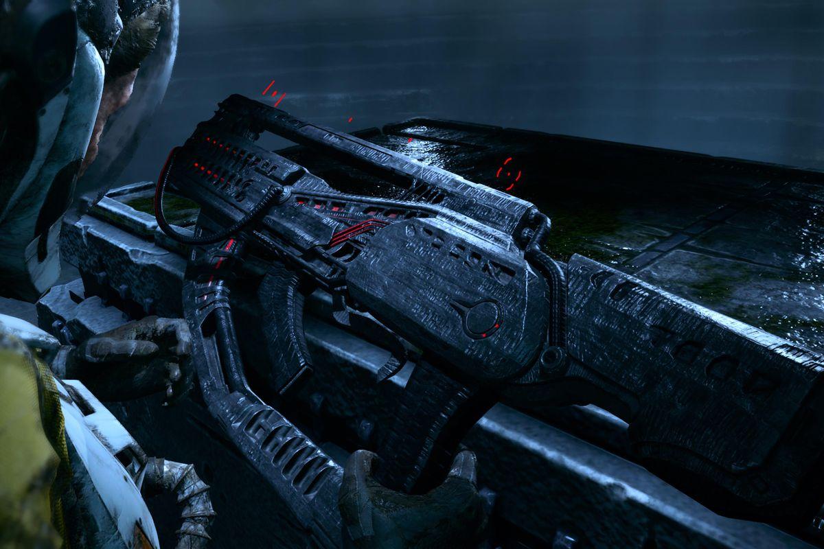 The main character of Returnal looks at a gun