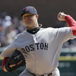 Boston Red Sox starting pitcher Jon Lester (31) throws during the second inning of a baseball game against the Detroit Tigers in Detroit, Thursday, April 5, 2012.