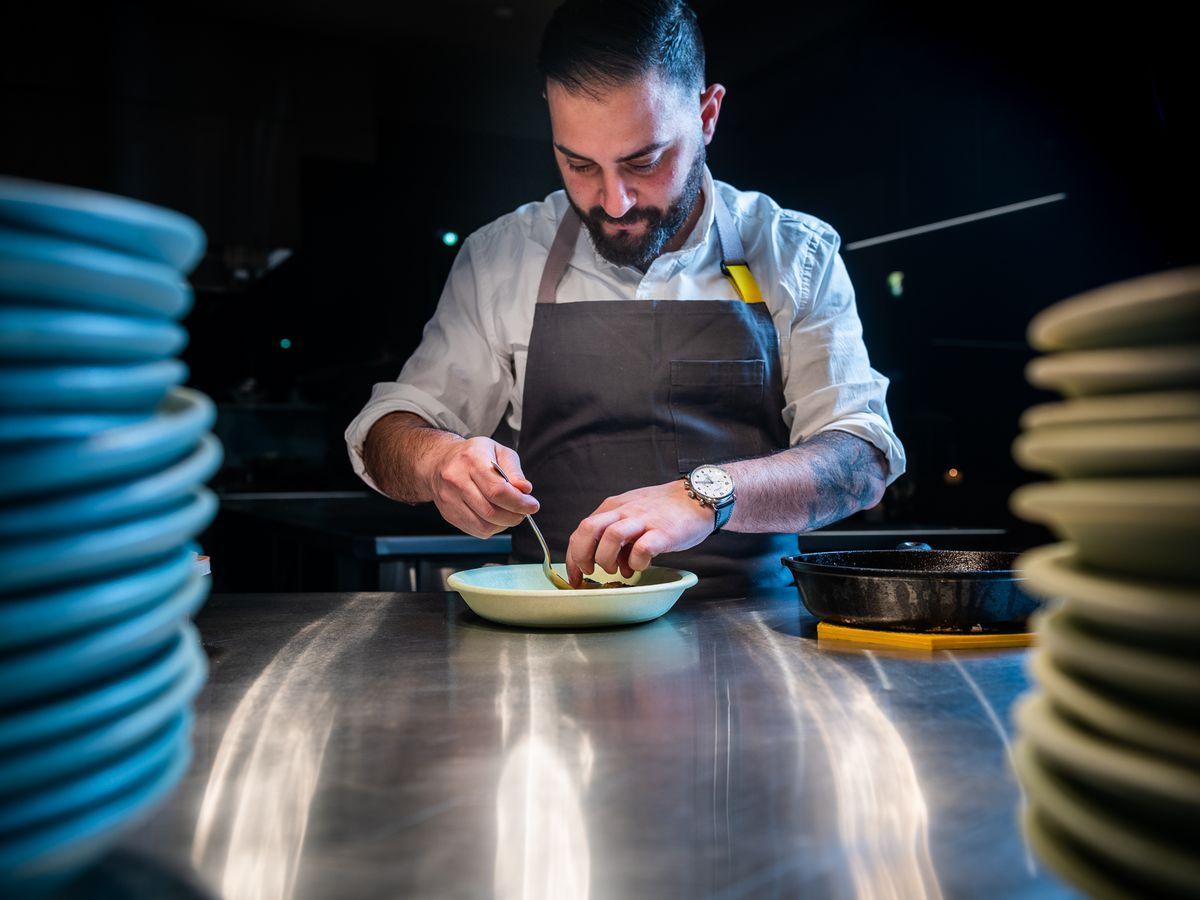 Chef Michael Rafidi plates a dish at Albi
