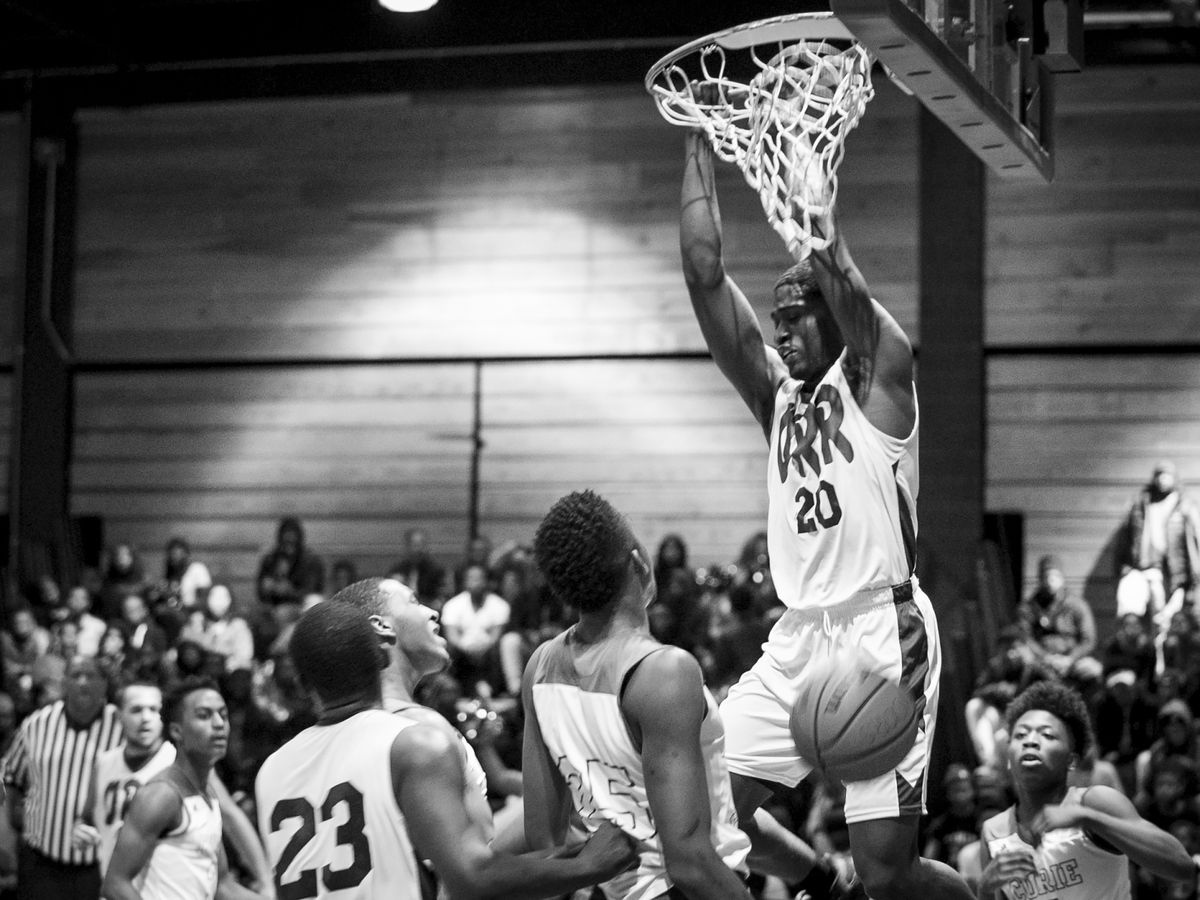 Orr Academy High School's Raekwon Drake gets a dunk during an away game against Curie Metropolitan High School, Feb. 15, 2017.