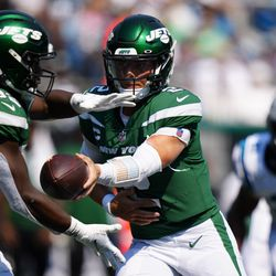 New York Jets quarterback Zach Wilson hands off to running back Michael Carter during the second half of an NFL football game Sunday, Sept. 12, 2021, in Charlotte, N.C.