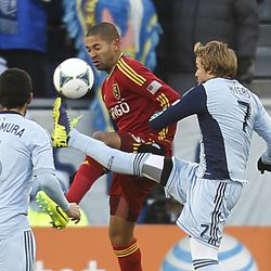 Real's Alvaro Saborio and Kansas City's Chance Myers work to control the ball as Real Salt Lake and Sporting KC play Saturday, Dec. 7, 2013 in MLS Cup action.