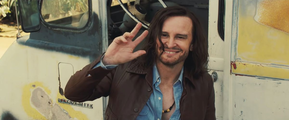 Damon Herriman as Charles Manson waves to Brad Pitt's Cliff off screen in Once Upon a Time ... in Hollywood