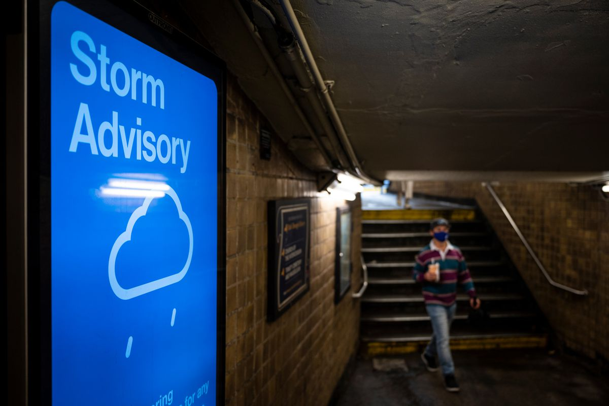 The MTA displayed a warning about rain inside the 157th Street Street station in Harlem, July 9, 2021.