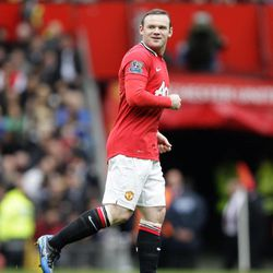 Manchester United's Wayne Rooney smiles after scoring a penalty against Queens Park Rangers during their English Premier League soccer match at Old Trafford Stadium, Manchester, England, Sunday, April 8, 2012.