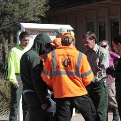 In this Friday, March 30, 2012, photo, provided by New Mexico Search and Rescue via Silver City Daily Press & Independent, search and rescue team members prepare to search for missing runner Micah True, in Silver City, N.M. Search teams intensified efforts Saturday, March 31, to find True, who mysteriously vanished four days ago after heading out from a lodge for a morning run in the rugged wilderness near New Mexico's Gila National Forest.