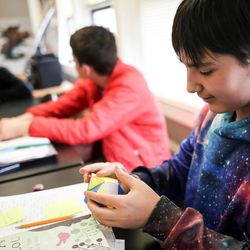 Doruk Toydemir, 12, works on solving a Skewb, similar to a Rubik's cube, in the Our CASA space at West High School in Salt Lake City on Friday, Feb. 24, 2017. The Our CASA spaces are part of an initiative to increase access to higher education for first-generation students and their families on Salt Lake City's west side. Doruk is part of the Extended Learning Program that allows middle schoolers to take high school courses.