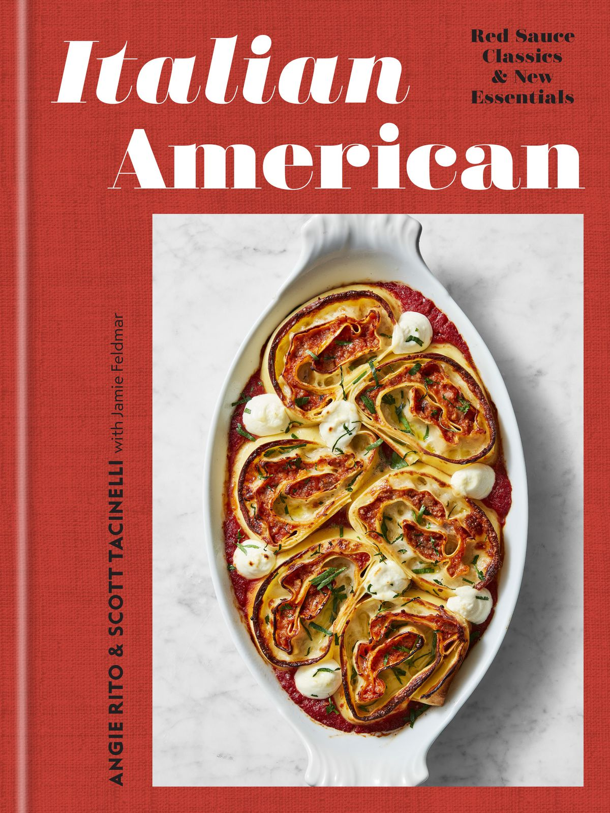A cookbook cover with a dish of spiral lasagna