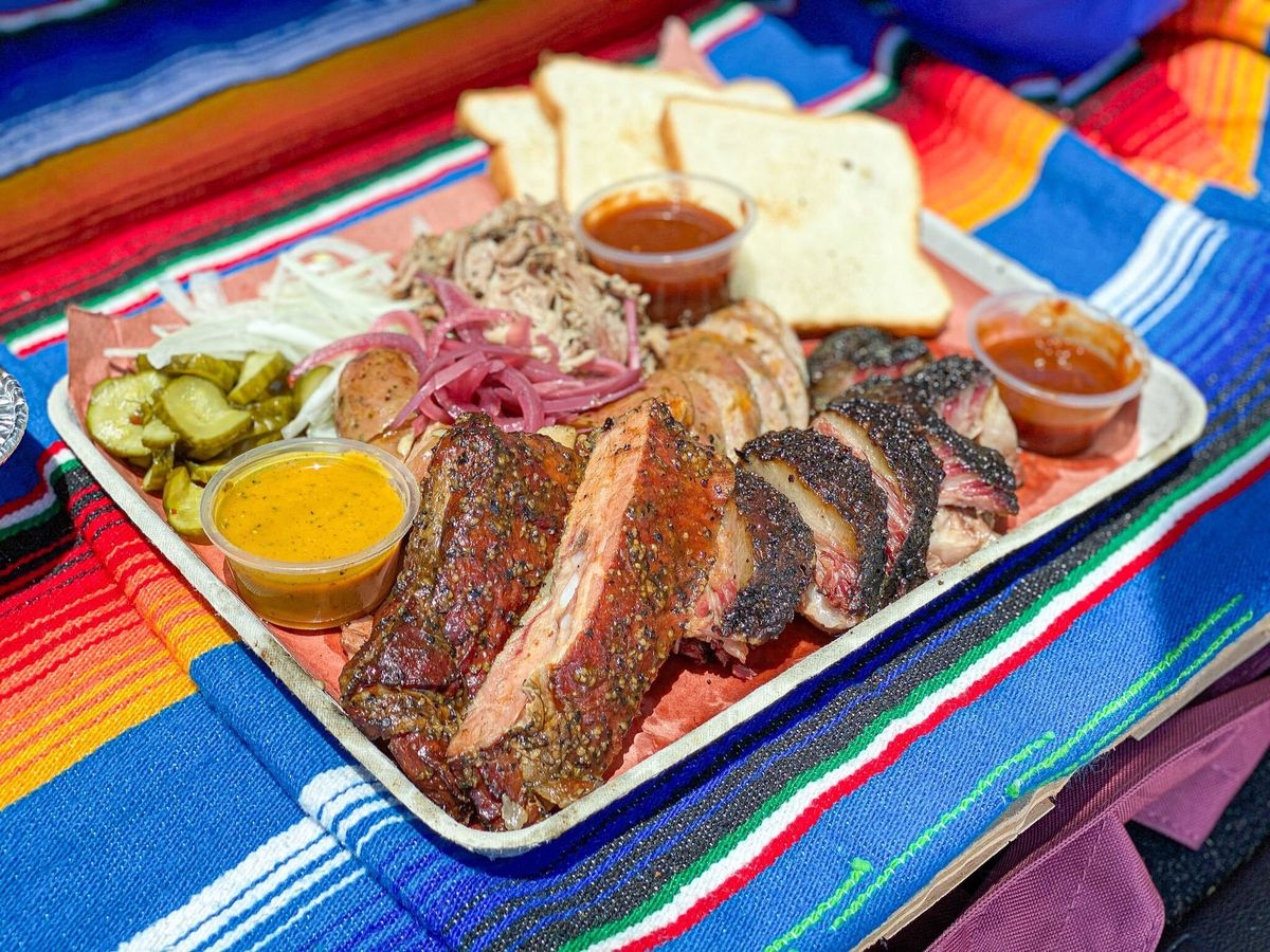 A full platter from Flatpoint BBQ on a colorful blanket.