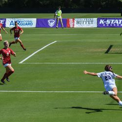 Kansas State midfielder Laramie Hall (23) winds up for a cross meant for midfielder Christina Baxter (19) amid a group of Oklahoma defenders on Sunday, Sept. 23, 2018, in Manhattan.