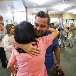 Alex Melecio hugs his mother in-law Gigi Turley after she graduated from the World Spiritual Health Organization during their combined board certification and chaplain graduation ceremony at the William E. Christofferson, Salt Lake Veterans Home on Wednesday, Aug. 2, 2017.