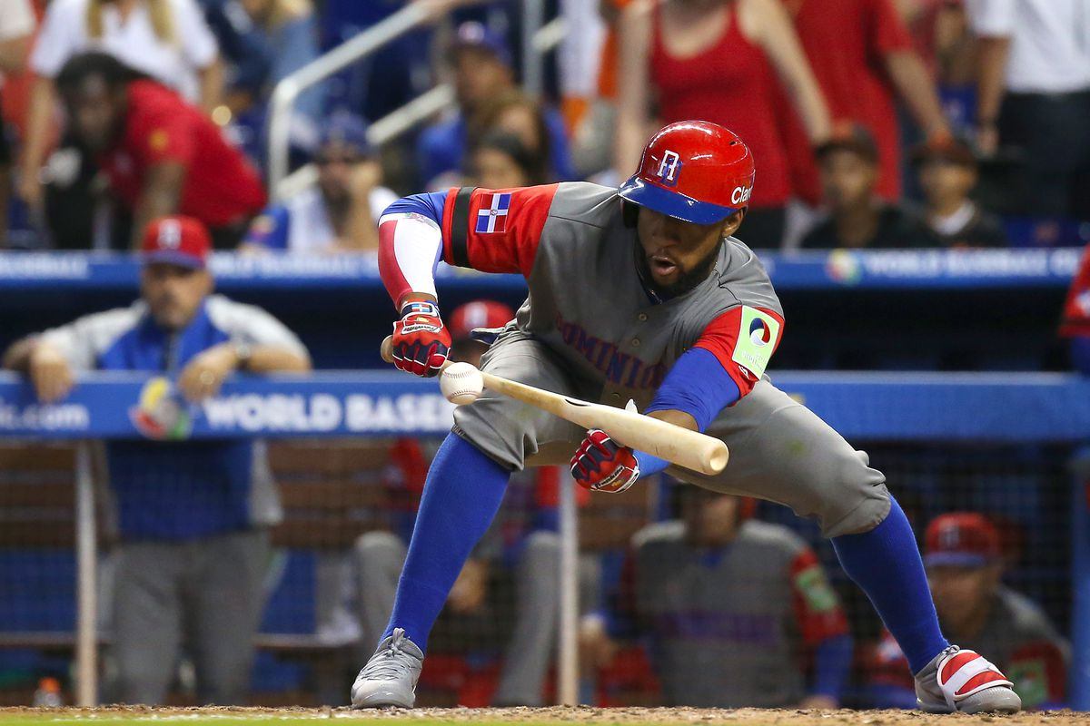 Dominican Republic left fielder Mel Rojas Jr. is out on a sacrifice bunt during the eleventh inning of a World Baseball Classic first round Pool C game against Colombia on Sunday, March 12, 2017 at Marlins Park in Miami, Fla.