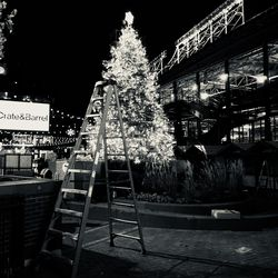 The Christmas tree being set up, in the southwest corner of the Park at Wrigley