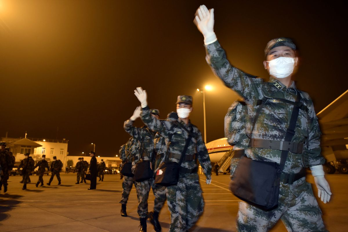 An 82-member medical team sent to the Republic of Liberia to assist in the fight against Ebola arrives at Chongqing Jiangbei International Airport in the morning on January 16, 2015 in Chongqing, Sichuan province of China.