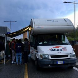 A mobile health clinic, which was donated by the LDS Church and used by MEDU (Doctors for Human Rights), assists refugees outside of Rome's Tiburtino train station.