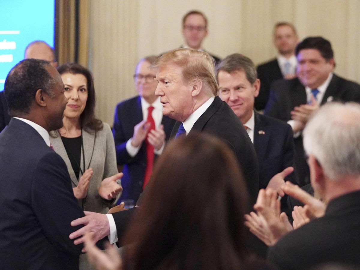 President Donald Trump is greeted by Housing and Urban Development Ben Carson as he arrives for the 2019 White House business session with governors in the State Dining Room of the White House in Washington, D.C. on Feb. 25, 2019. At the far right in the