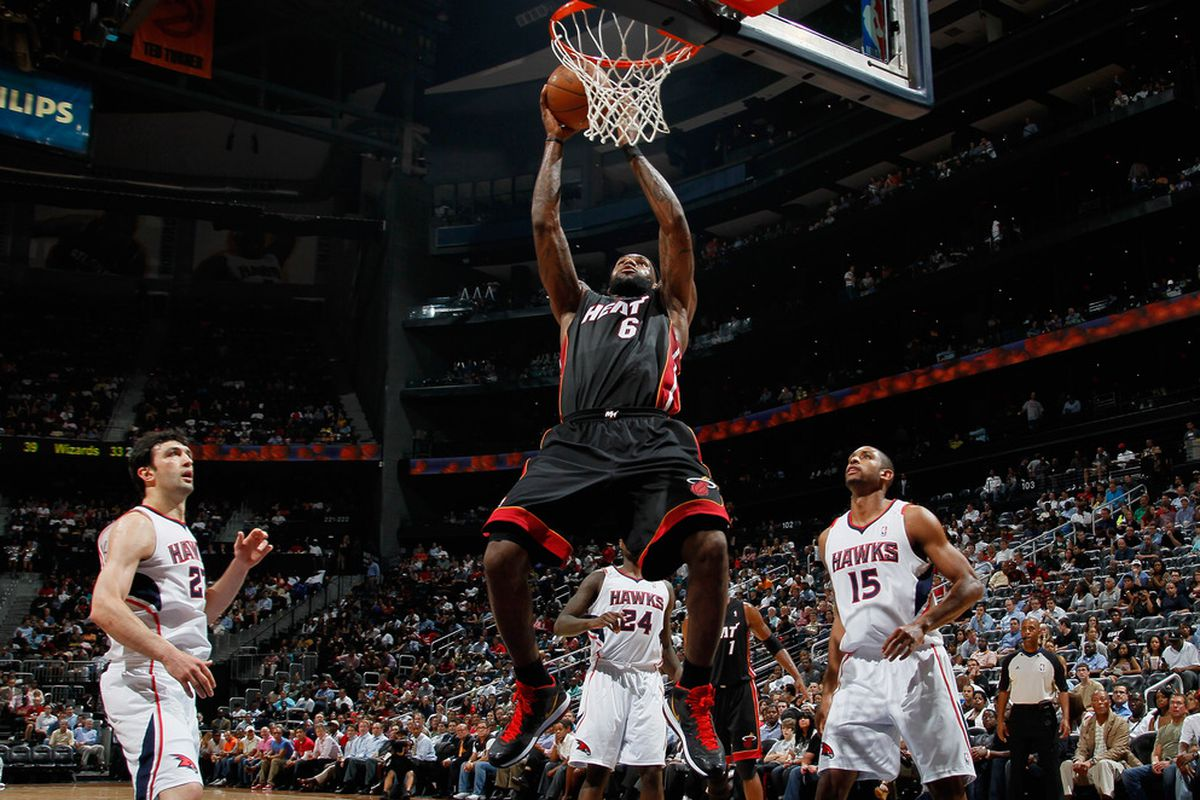 ATLANTA, GA - APRIL 11:  LeBron James of the Miami Heat grabs an alley oop for a layup against the Atlanta Hawks at Philips Arena on April 11, 2011 in Atlanta, Georgia.  (Photo by Kevin C. Cox/Getty Images)