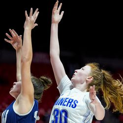 Bingham's Samantha Holman goes to the hoop against Copper Hills' Sam Rollins in a 6A girls basketball semifinal game at the Huntsman Center in Salt Lake City on Friday, Feb. 28, 2020.