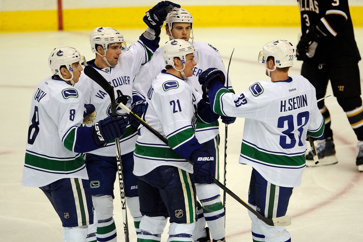 Henrik celebrates with his new linemates that dont' look like him. Takes me back to 2009...