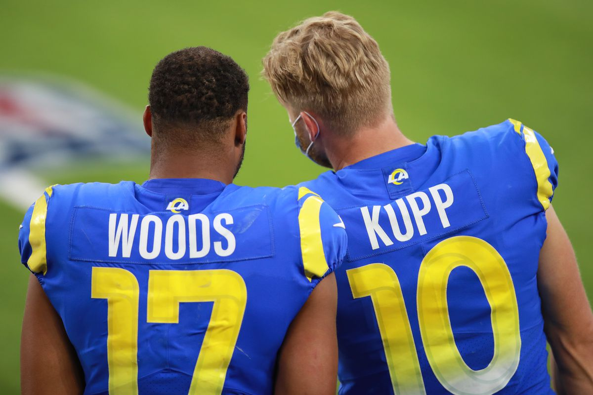 Robert Woods #17 of the Los Angeles Rams and Cooper Kupp #10 of the Los Angeles Rams chat on the sidelines in the fourth quarter against the San Francisco 49ers at SoFi Stadium on November 29, 2020 in Inglewood, California.
