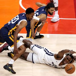 Utah Jazz White team forward Jarrell Brantley (5) dives for the ball as Utah Jazz Blue guard Kyle Fogg (50) and Utah Jazz Blue team guard Isaiah Wright (46) defend as the Utah Jazz Blue and White teams play in summer league action at Vivint Smart Home Arena in Salt Lake City on Friday, Aug. 6, 2021.