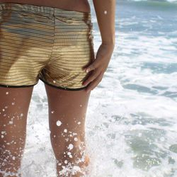 """Gold Disco Track Shorts, $48 at <a href=""""http://www.betabrand.com/gold-reflective-disco-sport-shorts.html"""">Betabrand</a>."""