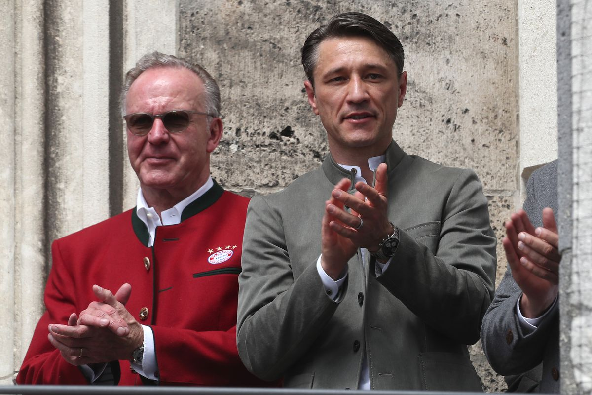 MUNICH, GERMANY - MAY 26: Team coach Niko Kovac (R) of FC Bayern Muenchen and CEO of FC Bayern Muenchen Karl-Heinz Rummenigge celebrate winning the Bundesliga title and the German Cup title for the season 2018/19 on the balcony of the town hall at Marienplatz on May 26, 2019 in Munich, Germany.