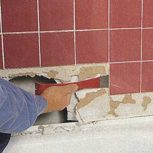 <p>USE A FLAT PRY bar to remove tiles that are firmly stuck to the wall. Don't pry under the corner of a tile or you'll crack it.</p>