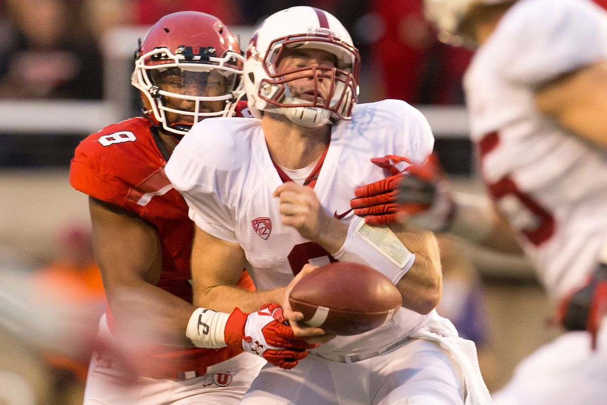 Nate Orchard (shown here sacking Stanford quarterback Kevin Hogan during last season's 27-21 upset of the then no. 5 Cardinal) is tied for second in the Pac-12 in sacks at 2.5.