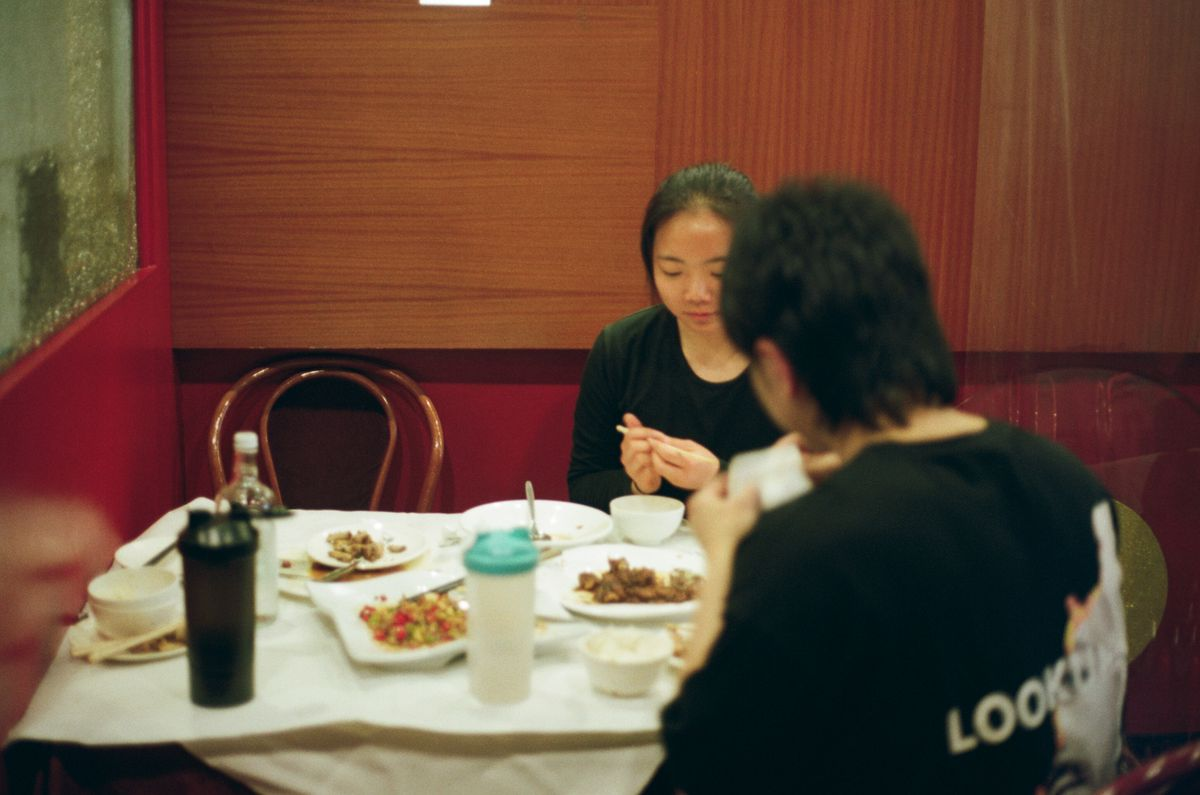 Two guests sit at a table inside Food House in Chinatown, one of the city's best restaurants