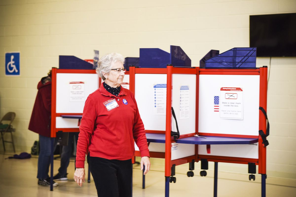 A voter casts her ballot at a polling station during the 2018 mid-term election in Arlington, Virginia, on November 6, 2018.