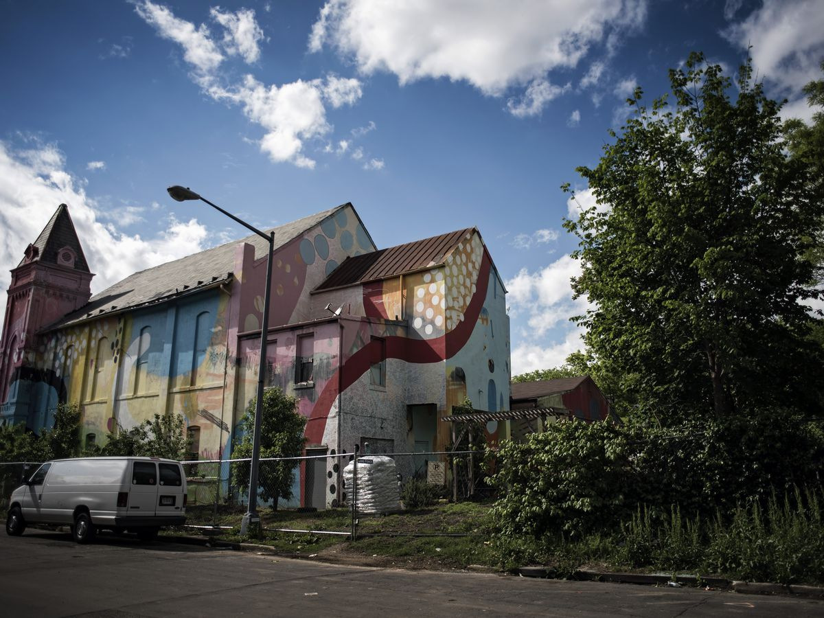The exterior of the Blind Whino Culture House in Washington D.C. The facade has a colorful mural painted on it.