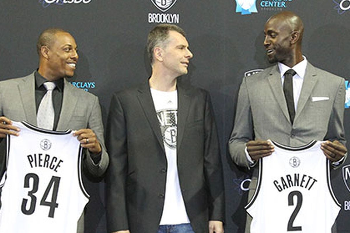 Prokhorov talks to Garnett at trade presser (Adam Pantozzi)