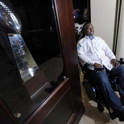 O.J. Brigance, former linebacker and current director of player development for the Baltimore Ravens, sits near the Ravens' Vince Lombardi Trophy from the 2001 Super Bowl, in which Brigance played, at the NFL football team's practice facility in Owings Mills, Md., Sept. 5, 2012. Brigance was diagnosed in 2007 with amyotrophic lateral sclerosis, or ALS, also known as Lou Gehrig's disease. The manner in which he's fought ALS has been inspirational to the Ravens, notably linebacker Ray Lewis.