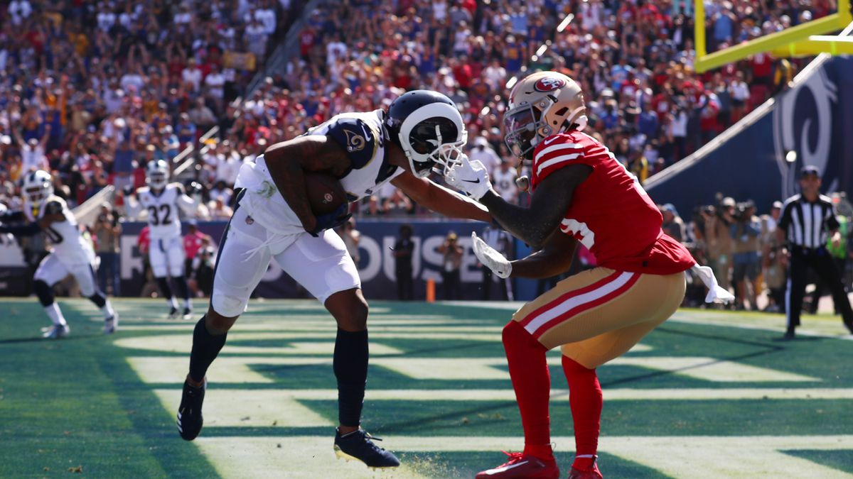 Deebo Samuel of the San Francisco 49ers pulls down Marcus Peters of the Los Angeles Rams by the facemask resulting in a penalty on the San Francisco 49ers at Los Angeles Memorial Coliseum on October 13, 2019 in Los Angeles, California.