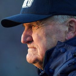 BYU football coach LaVell Edwards watches his team as the sun sets in his eyes during his final game at Cougar (now LaVell Edwards Stadium) on Saturday, Nov. 18, 2000.