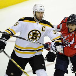 Washington Capitals left wing Alex Ovechkin (8), of Russia, tangles with Boston Bruins defenseman Zdeno Chara (33), of Slovakia, during the first period of Game 6 of an NHL hockey Stanley Cup first-round playoff series, Sunday, April 22, 2012, in Washington.