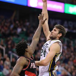 Utah Jazz center Jeff Withey (24) shoots as the Utah Jazz and the Portland Trailblazers play  in  NBA basketball Thursday, Dec. 31, 2015, in Salt Lake City.