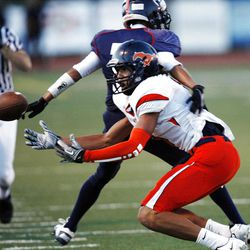 Mountain Crest's #6 Faimafili Laulu Pututau reaches out for a ball as time runs out in the first half of play as Woods Cross and Mountain Crest play Friday, Aug. 31, 2012.